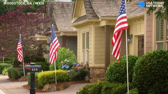 Neighbors face fines for flying American flags