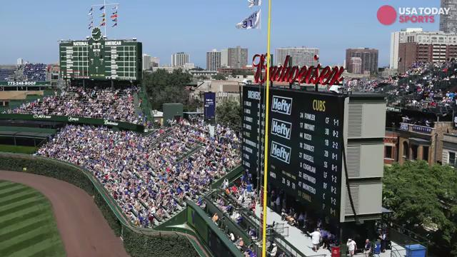 Cubs fan dies after falling over railing at Wrigley Field