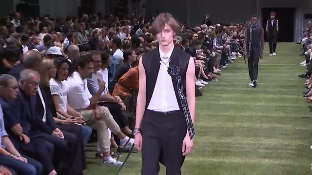 Dior relaunches male suit at star-stuffed show