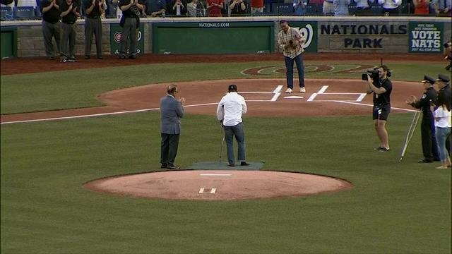 Injured Officer Throws First Pitch in Washington