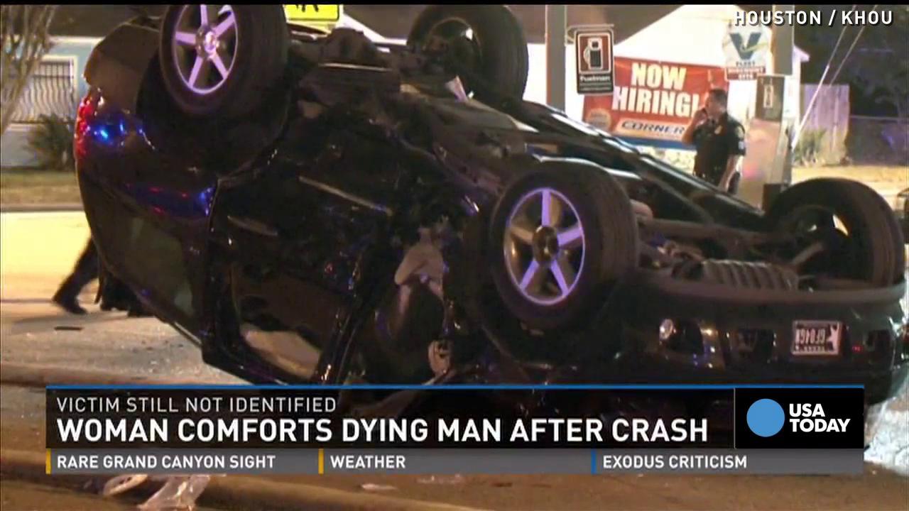 Woman comforts dying man after car crash
