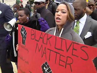 Protestors march through Baltimore streets