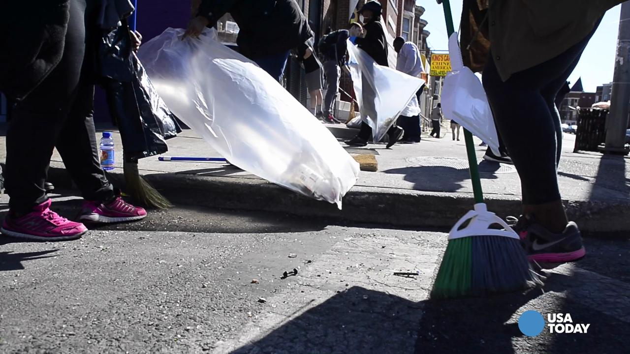 Baltimore cleans the streets following previous day after riots