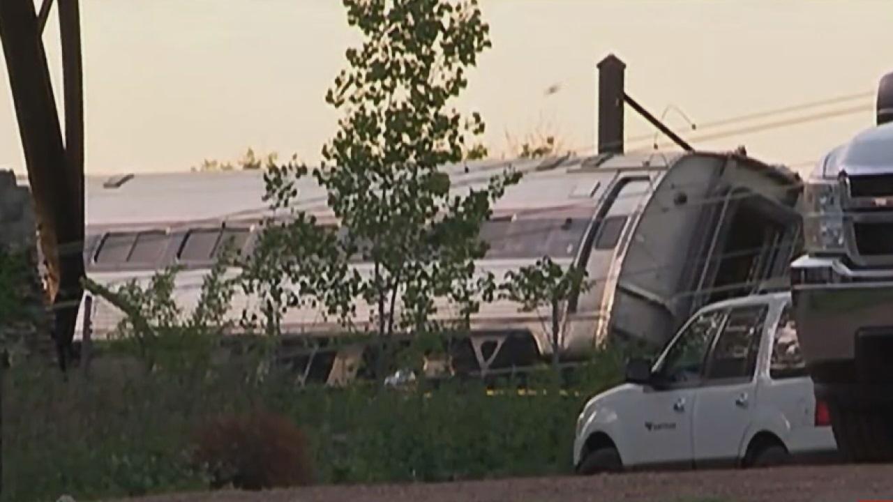 Deadly Amtrak train crash in Philadelphia 'devastating'