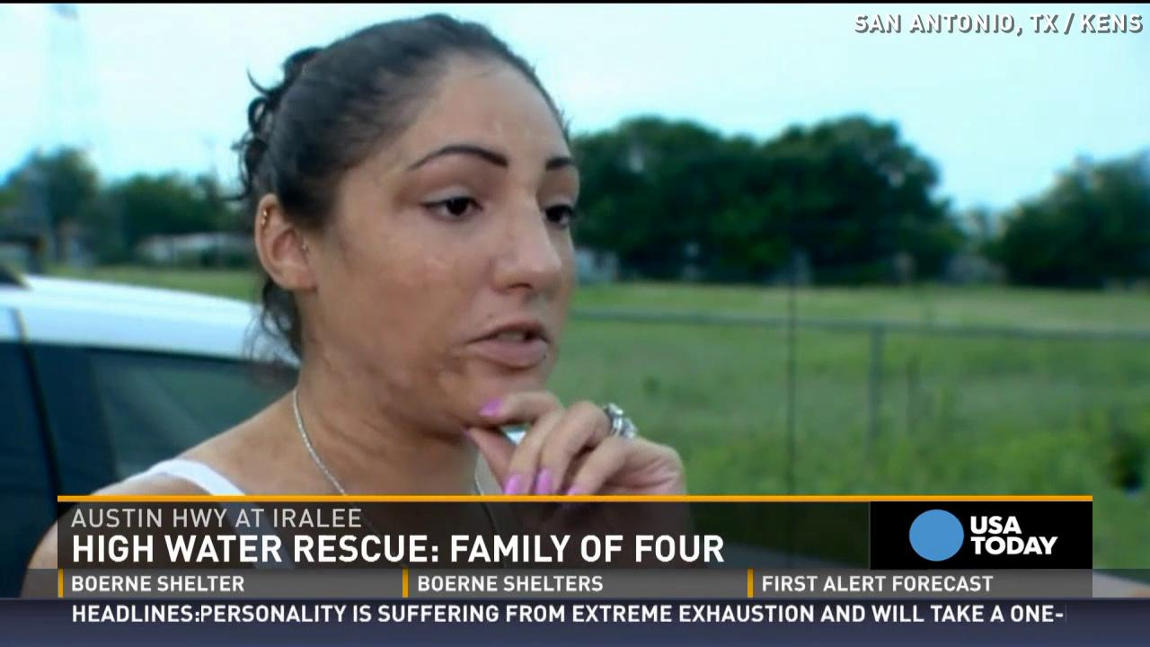 Family stuck in car in rising flood fight their way out