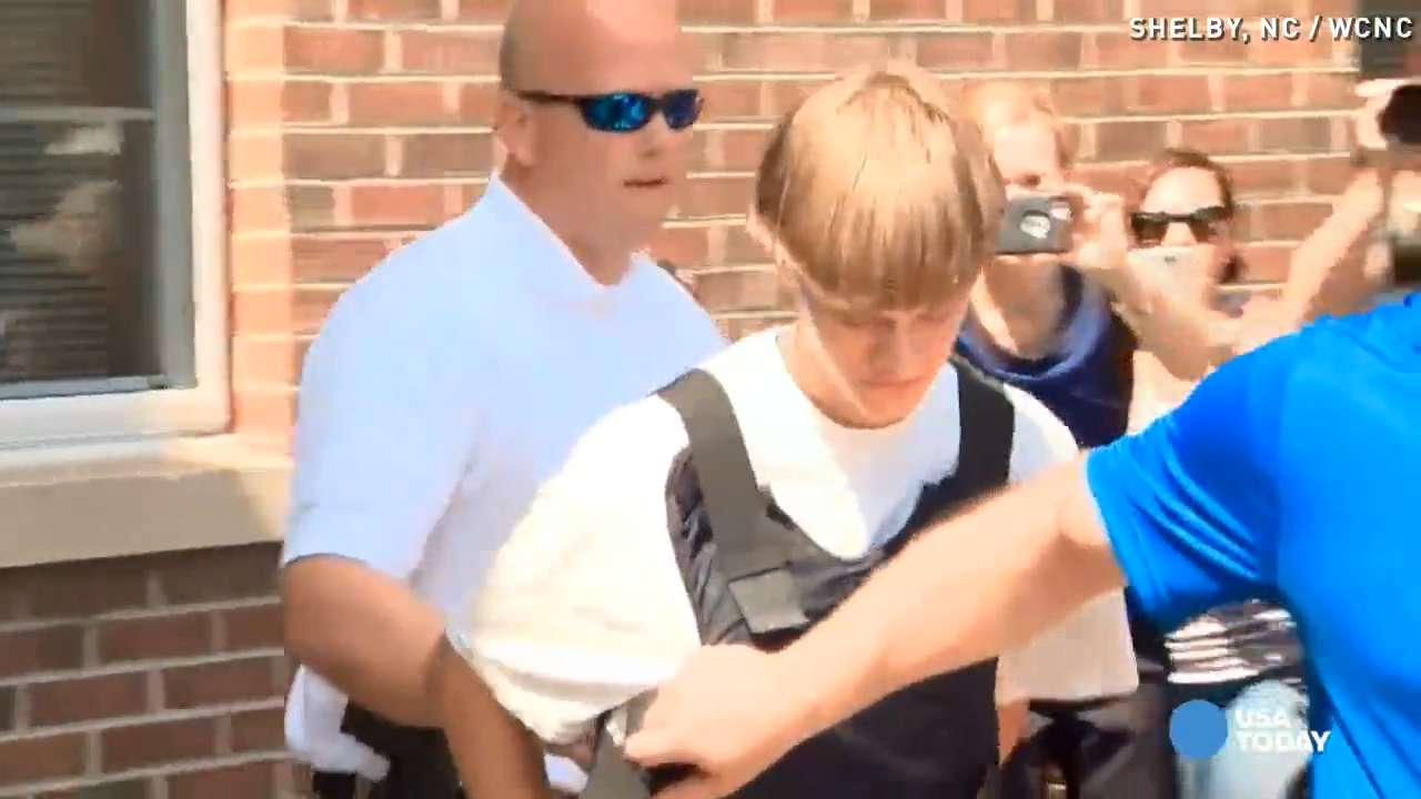 Dylann Roof led from station in bullet proof vest