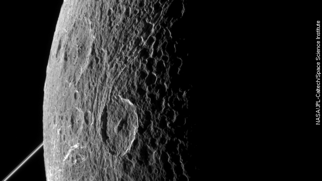 Cassini probe has close encounter with Saturn moon Dione