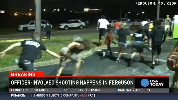 Police in Ferguson shoot man suspected of firing at them