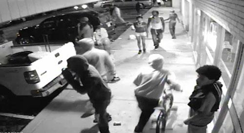 Ferguson surveillance video shows possible gunman