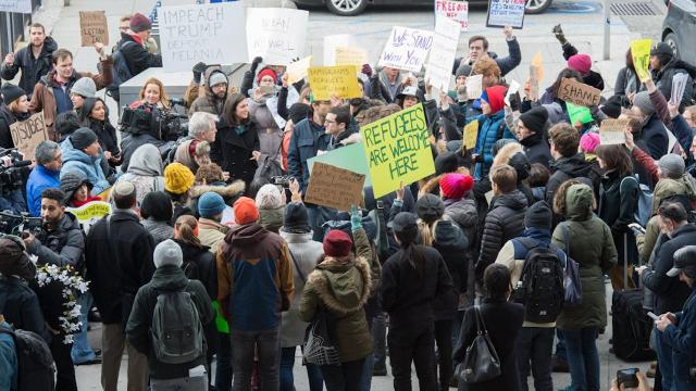 Protestors rally at JFK Airport over President Trump's executive order