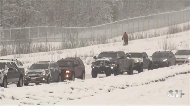 One Alaskan was undeterred by a heavy snowfall in Achorage, Alaska - taking to a bike to ride along a highway, past motorists stuck in heavy traffic. (March 29)