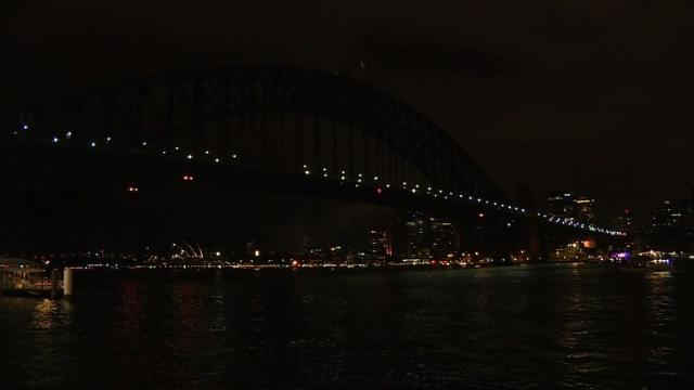 Iconic buildings and monuments around the world plunged into darkness for sixty minutes on Saturday to mark Earth Hour and draw attention to climate change.