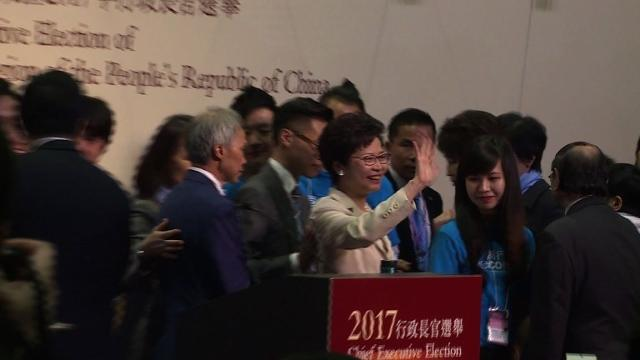 Hong Kong's new leader Carrie Lam pledges to mend political rifts after winning a vote dismissed as a sham by democracy activists who fear the loss of the city's cherished freedoms.