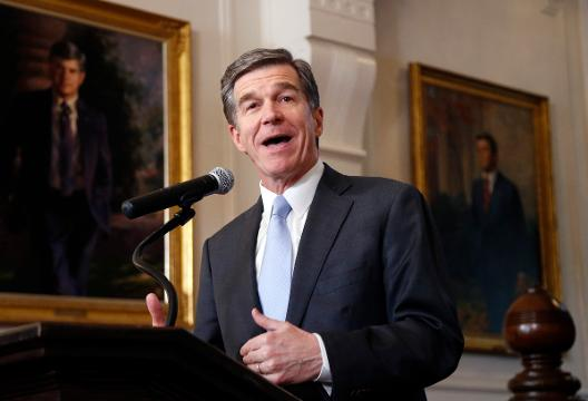 North Carolina Governor Roy Cooper signed a compromise measure rolling back the state's controversial 'bathroom bill.'