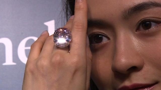 A plum-sized pink diamond is expected to fetch a record price, more than $60 million, breaking the world record for a gemstone when it goes under the hammer in Hong Kong in April, 2017