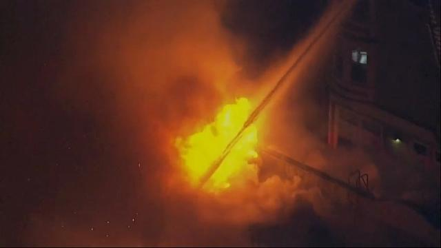 Northern California firefighters are battling a massive four-alarm fire at a residential building in West Oakland. KTVU-TV reports it is unclear if people are still inside. (March 27)