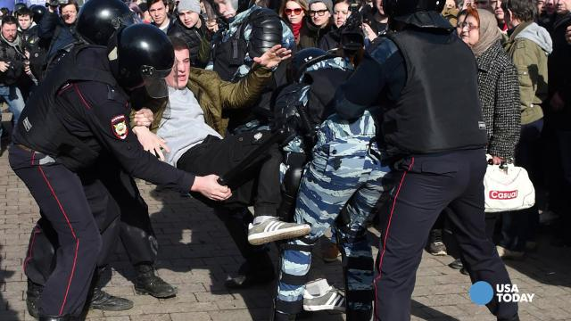Protesters took to the streets in Moscow on Sunday, answering calls from a prominent opposition figure to hold anti-corruption demonstrations across Russia.