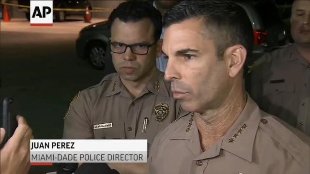 Two Miami-Dade County undercover police officers were wounded in 'an ambush-style' shooting late Monday. Other officers rushed them to a hospital in the back of a pickup truck. The two were listed in stable condition. (March 28)