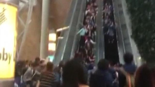 At least 18 shoppers at a Hong Kong mall were injured on Saturday when a escalator suddenly reversed at an increased speed