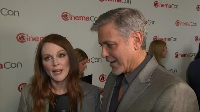 """While promoting the Coen brothers' latest film """"Suburbicon"""" at CinemaCon in Las Vegas, George Clooney and Julianne Moore poke fun at co-star Matt Damon's casual attire and attempt to explain the plot of the film. (March 30)"""