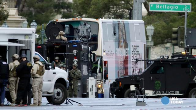 The gunman in a fatal shooting on the Las Vegas strip barricaded himself inside a public bus to evade police. Las vegas police say he has surrendered peacefully after shutting down the busy corridor for hours.
