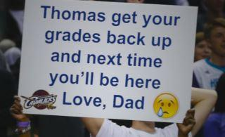 A dad trolled his son over his bad grades by going to two NBA games with clever messages on poster boards. You are going to want to see what they said.