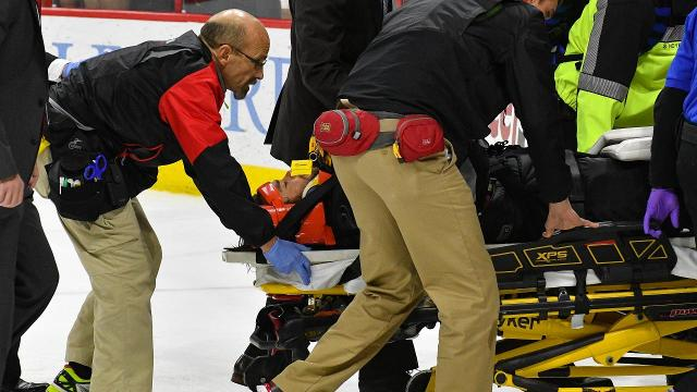 Hurricanes goalie Eddie Lack exited the ice on a stretcher after being injured on the game's final play Monday. Lack was hurt when Red Wings center Andreas Athanasiou collided with him in the process of scoring the game-winning goal in overtime.