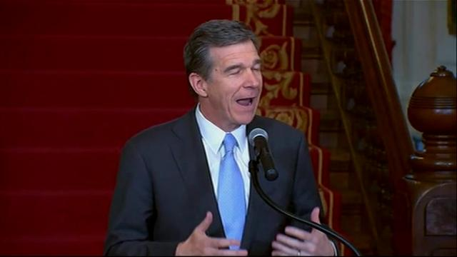 """North Carolina Gov. Roy Cooper says he has signed into law a measure that rolls back the state's """"bathroom bill.""""  The Democratic governor signed the bill Thursday despite criticisms from the transgender rights community. (March 30)"""