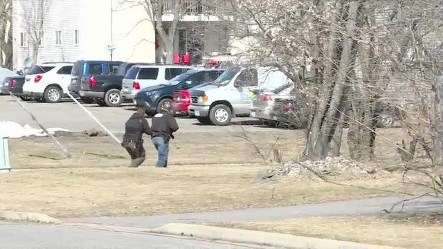 A police officer and three other people were shot dead in three separate towns in northern Wisconsin on Wednesday. A suspect was taken into custody after a standoff that lasted several hours. (March 23)