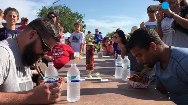 Speed-eating contestants inhale a pound of bacon