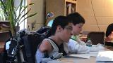 Boy without arms or legs testing robotic arm