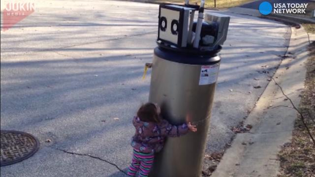 Little girl adorably mistakes water heater for robot