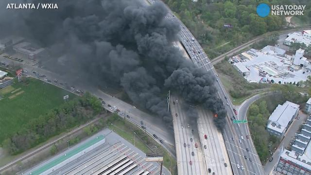 Fiery blaze destroys portion of Atlanta interstate
