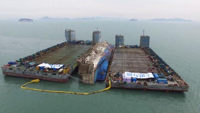 Salvage operators are preparing to move South Korea's sunken Sewol ferry on to another vessel to transfer it to port, nearly three years after it went down with the loss of more than 300 lives.