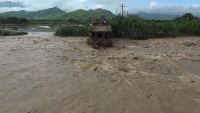 Hundreds of families were stranded in Peru after a bridge collapsed due to the rising Chancay river, as torrential downpours in the country have killed at least 90 people and left more than 120,000 without a home.