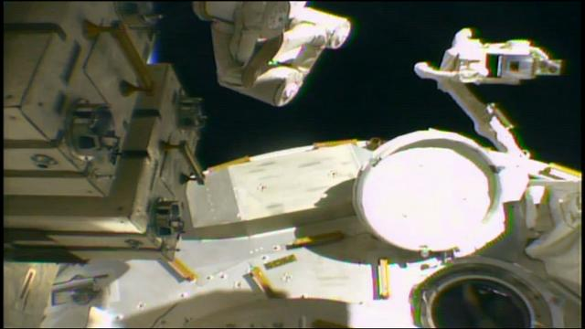 Spacewalking astronauts prepped the International Space Station on Friday for a new parking spot reserved for commercial crew capsules. (March 24)