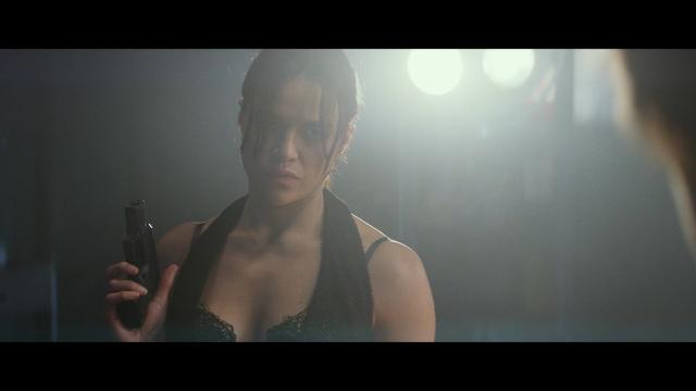 A hitman wakes up as a woman, played by Michelle Rodriguez, after having his gender reassigned as payback for a past hit in 'The Assignment.'