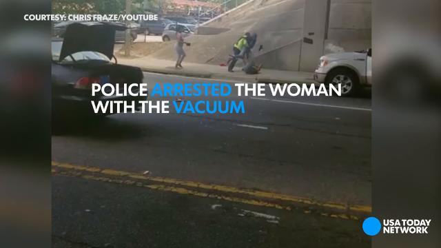 Woman pulls out the vacuum during road rage fight