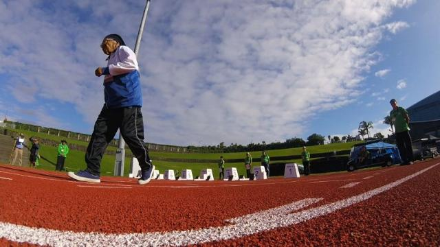 With a jaunty victory dance, 101-year-old Man Kaur celebrates winning the 100 metres sprint at the World Masters Games in Auckland, the 17th gold medal in the Indian athlete's remarkable late-blooming career.
