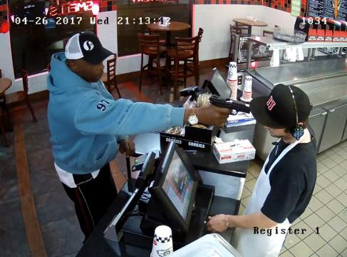 When a man robbed the cashier and stuck a gun in his face, he slowly and calmly gave the robber what he wanted.