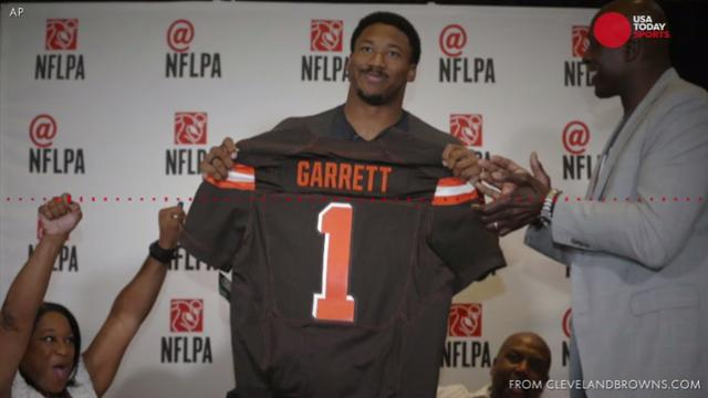 Jim Brown let Garrett know he would be drafted by the Cleveland Browns.