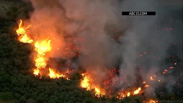 The Maricopa County, Arizona Sheriff's Office says a brush fire near the Salt River shut down part of Bush Highway. The fire is growing, with 30 mph wind gusts pushing the flames. Officials estimated late Tuesday that it burned nearly 25 acres. (April 26)