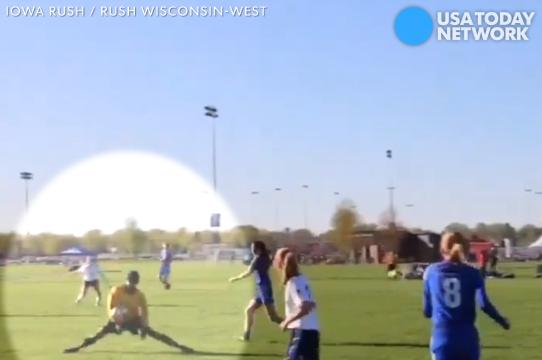Jerry Nash impressively avoids getting hit with a ball at an Iowa Rush soccer game.