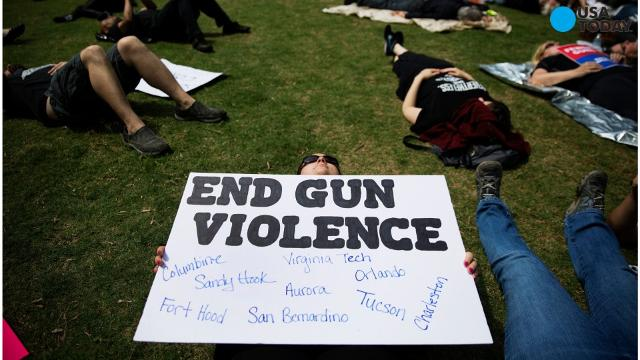 Hundreds of demonstrators blasted America's gun policy as President Donald Trump spoke to the NRA in Atlanta.