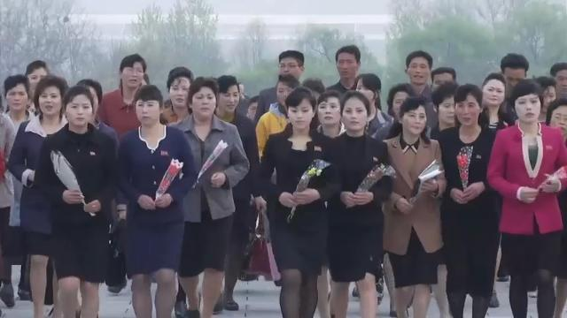 North Koreans placed floral tributes at the foot of giant statues of Kim Il Sung and Kim Jong Il on Mansu Hill in Pyongyang on Tuesday as the country marked the founding anniversary of its armed forces. (April 25)