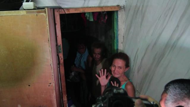 A dozen people have been found stuffed inside a closet-sized cell hidden behind a book shelf in a Philippine police station, triggering further alarm about abuse under President Rodrigo Duterte's deadly war on drugs.