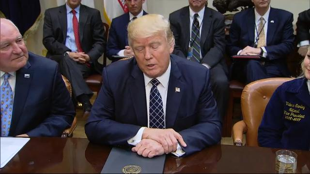 President Donald Trump has signed an executive order that will direct his new agriculture secretary to identify and eliminate what Trump says are unnecessary regulations. Trump also doubled down on promises to build a southern border wall. (April 25)