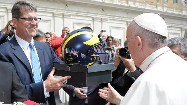Pope Francis does not wear khakis, but he is now the proud owner of some custom Jordans and a Michigan football helmet.
