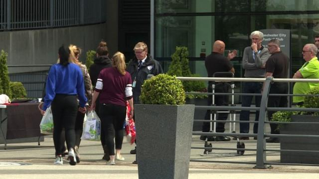 Well-wishers deliver food and games for children gathered at a support centre for victims of the Manchester attack at football club Manchester City's Etihad Stadium. Video provided by AFP