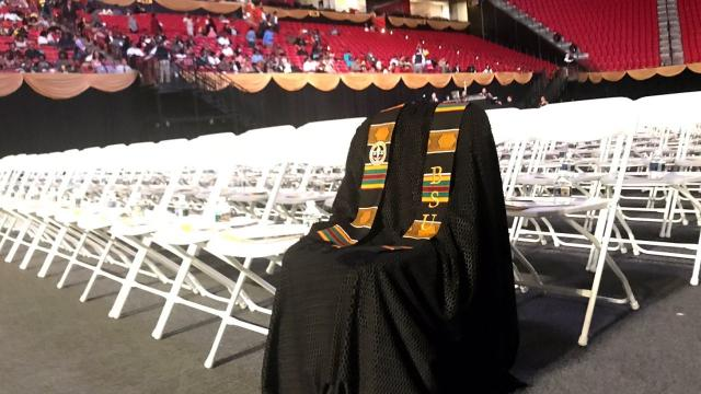 Richard Collins III's graduation gown was draped over a chair in the front row during Bowie State's ceremony in his memory.